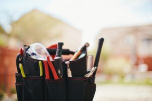 bag-of-tools-with-home-in-background