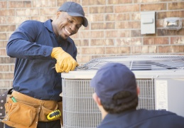 two-technicians-working-on-outside-air-conditioning-unit